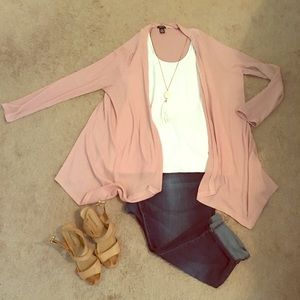 Light pink or salmon color cardigan